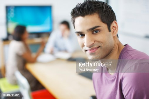 Smiling man in conference room : Stock Photo