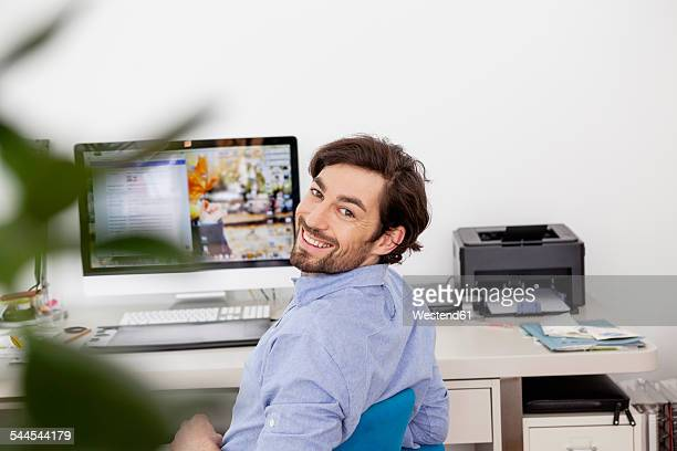 Smiling man in home office