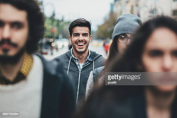 Smiling man in the crowd