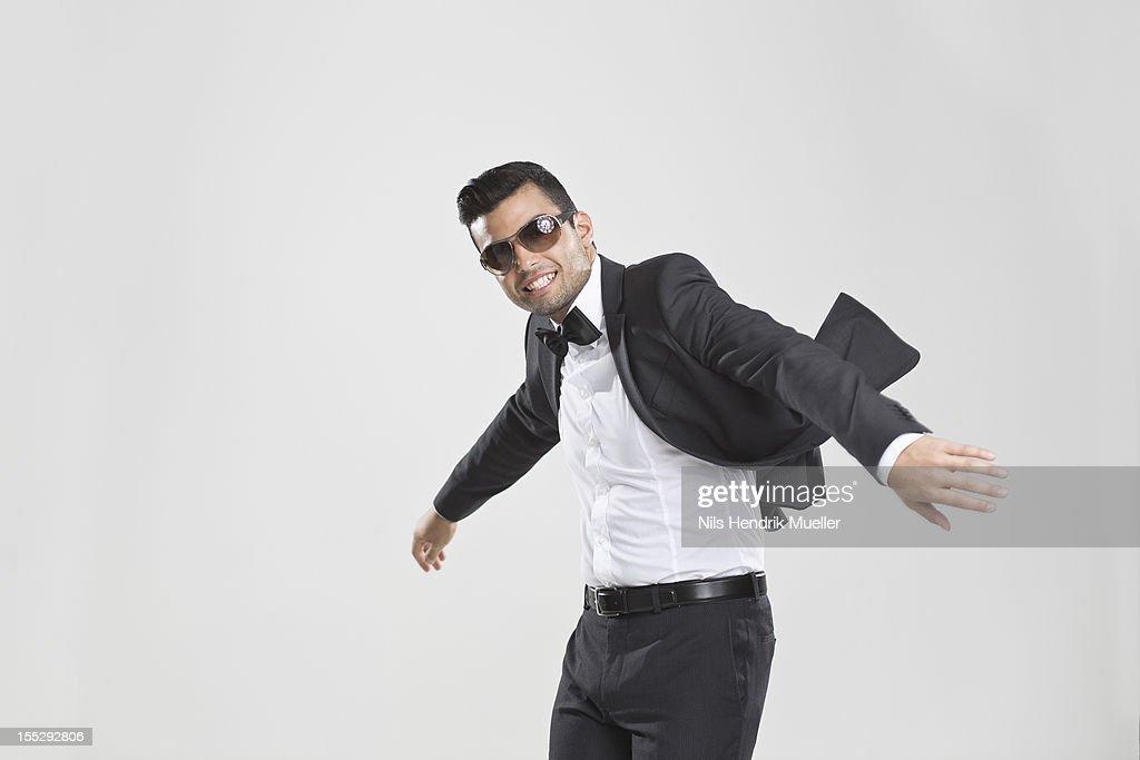 Smiling man in tuxedo dancing : Stock Photo