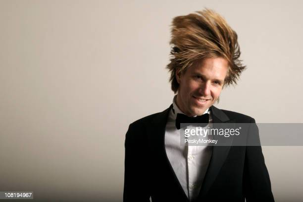 Smiling Man in Tuxedo Dancing with Blond Hair Flying