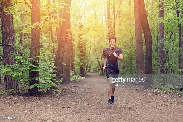 Smiling man jogging in the park