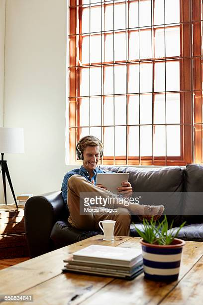 Smiling man listening music at home