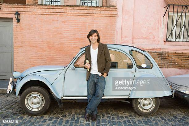 Smiling man next to car