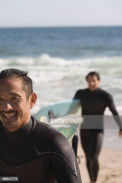 Smiling man on beach with his friend