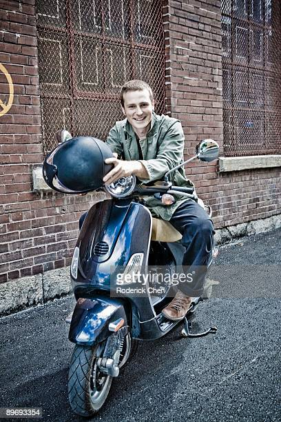 Smiling man on moped
