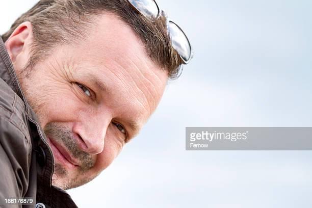 Smiling man outdoors, portrait