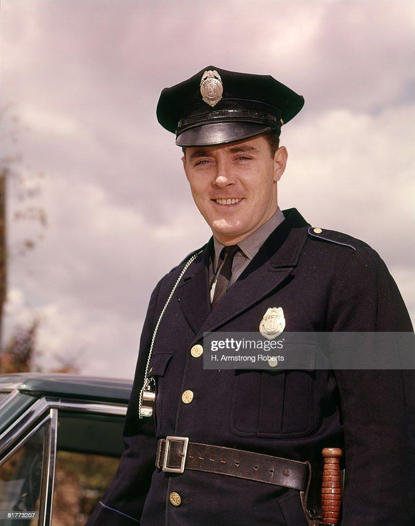 smiling man police uniform policeman policemen officer stock photo