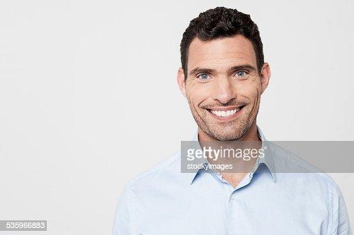 Smiling man posing casually : Stock Photo