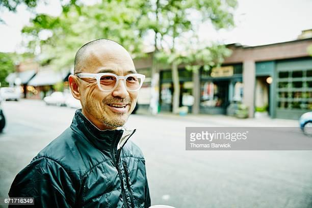 Smiling man running errands in neighborhood