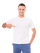 Smiling man showing empty copyspace on white t-shirt