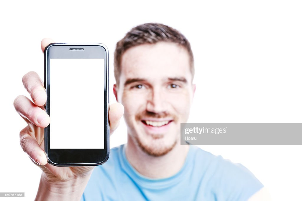 Smiling Man Shows a Phone