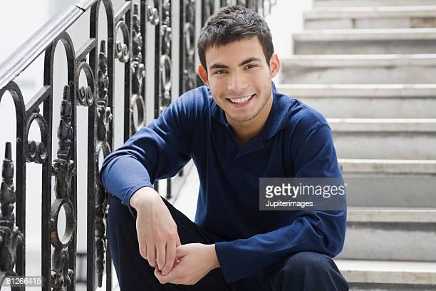 Smiling man sitting on stairs