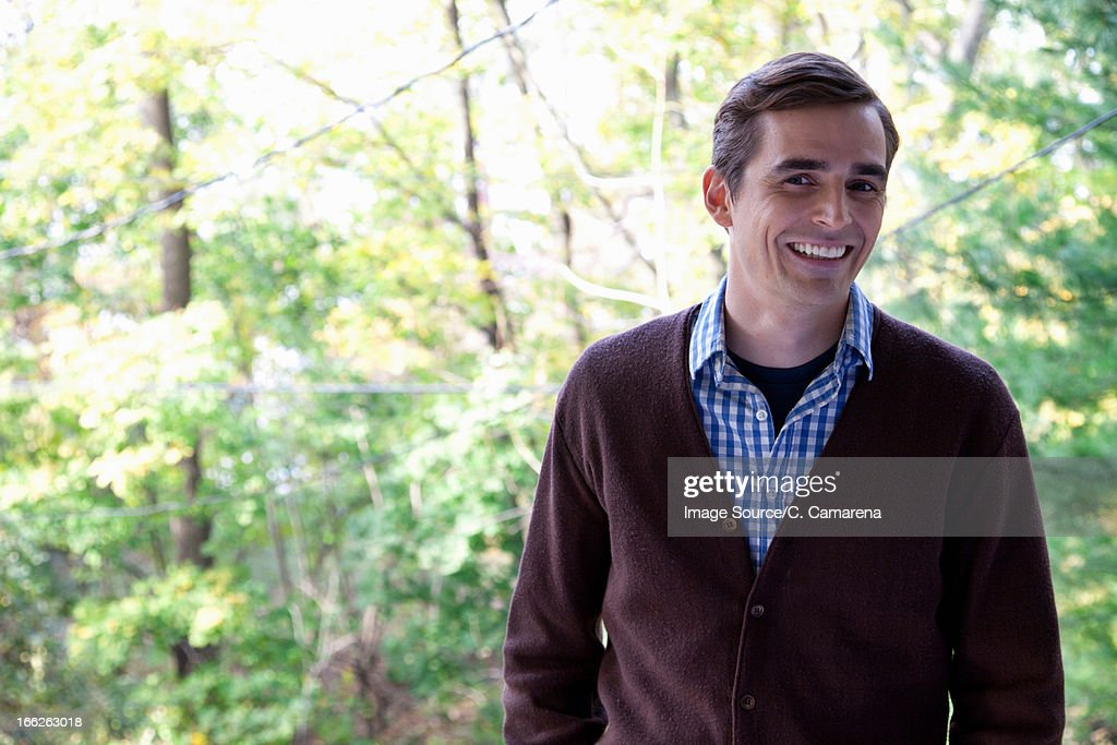 Smiling man standing outdoors : Stock Photo