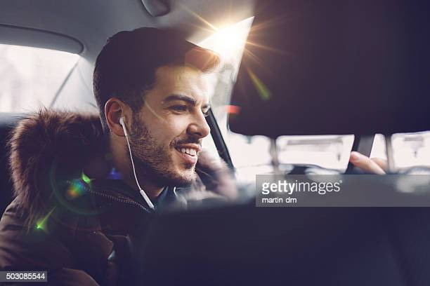 Smiling man travelling in car
