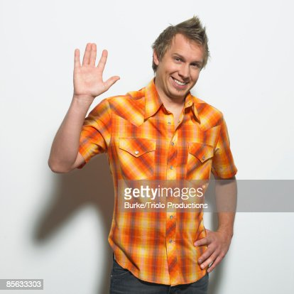 Smiling man waving