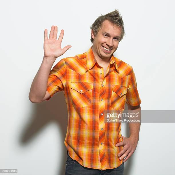 Smiling man waving