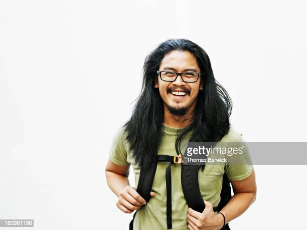 Smiling man wearing backpack
