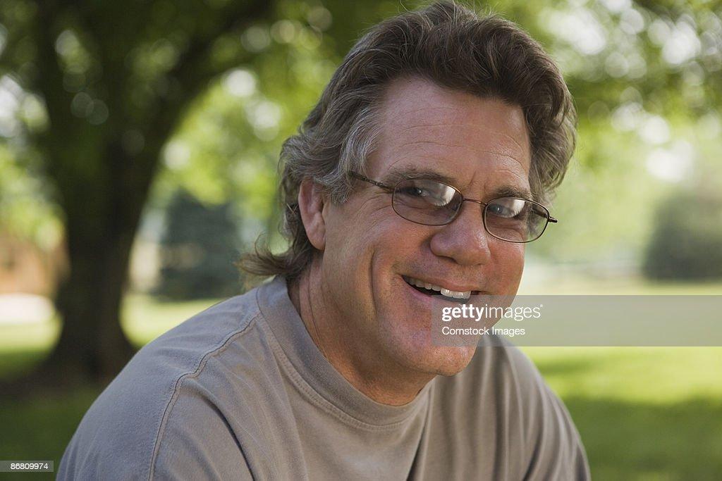 Smiling man wearing eyeglasses : Stock Photo