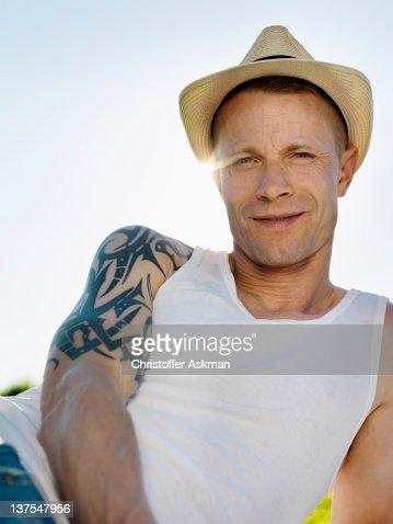 Smiling man wearing sunhat outdoors : Stock Photo