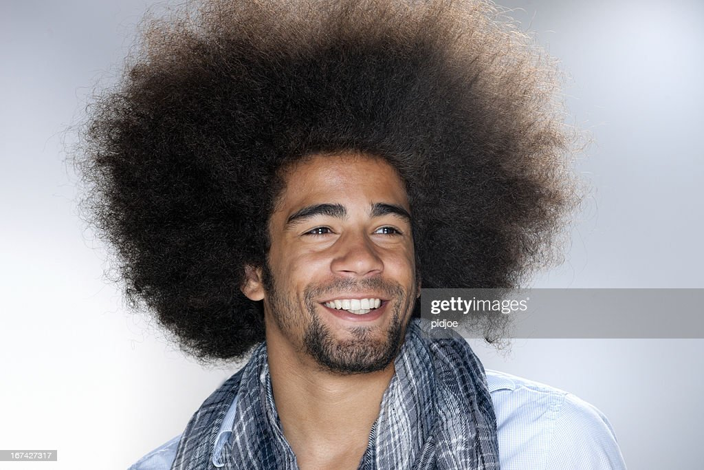 smiling man with afro hair : Stock Photo