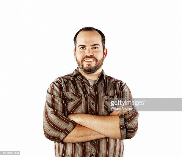 Smiling man with arms crossed