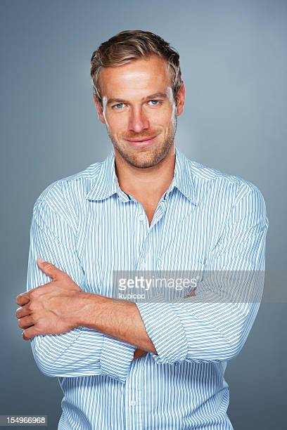 Smiling man with arms folded