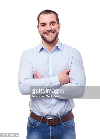Smiling man with crossed arms : Stock Photo