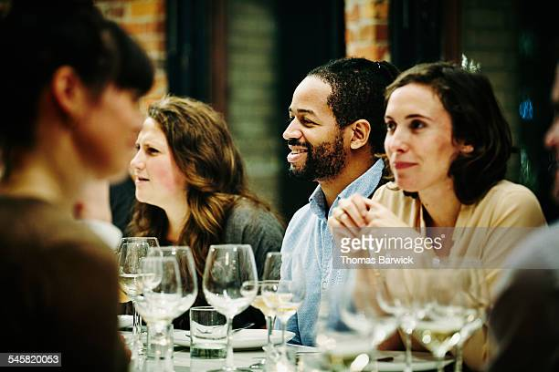 Smiling man with friends during dinner party
