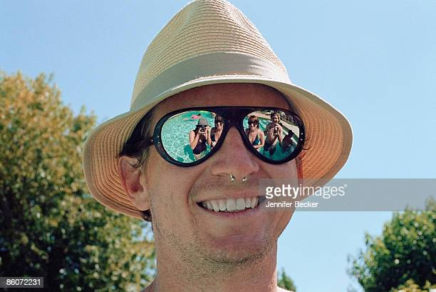 Smiling man with hat and sunglasses