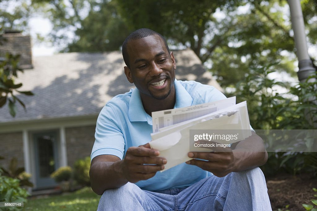 Smiling man with mail
