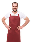 Smiling man with red apron on white background