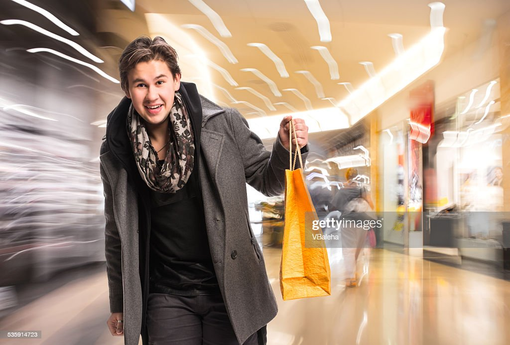 Smiling man with shopping bags : Stock Photo
