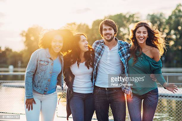 Smiling man with three women