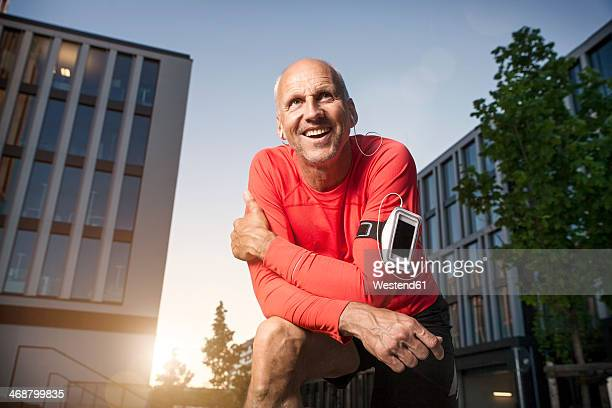 Smiling mature athletic man outdoors