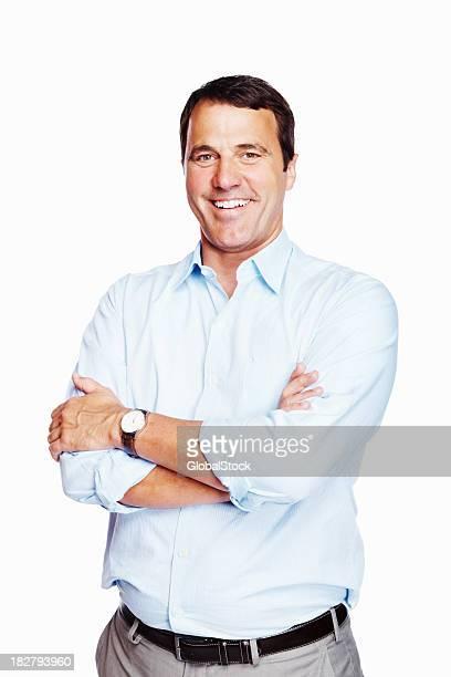 Souriant mature Homme d'affaires avec les mains pliées sur blanc