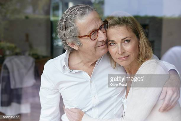 Smiling mature couple embracing