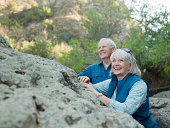 Smiling mature couple in natural setting