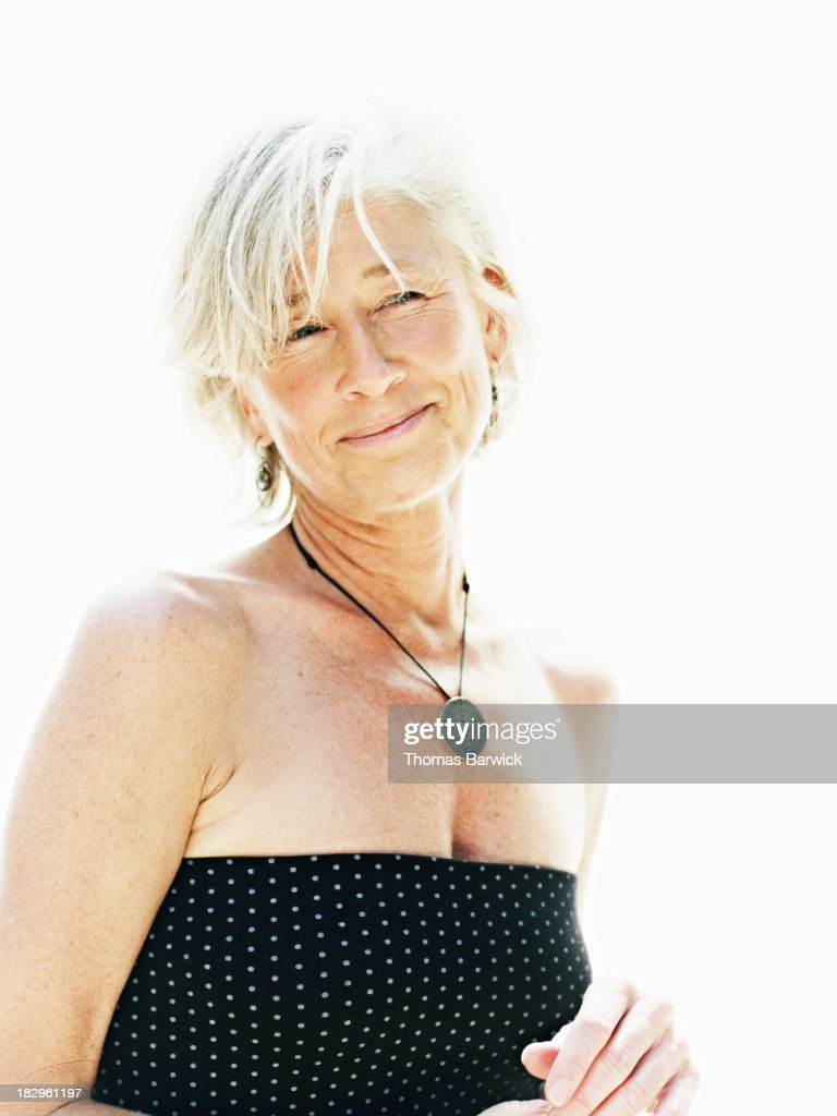 Smiling mature woman against white background