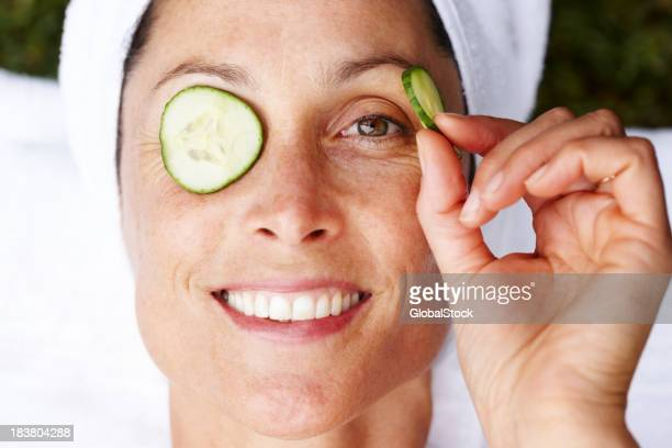 Smiling mature woman getting beauty treatment