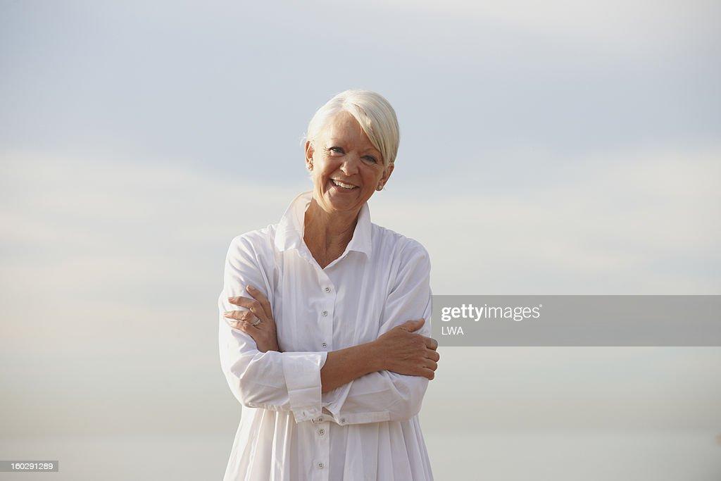 Smiling mature woman : Stock Photo