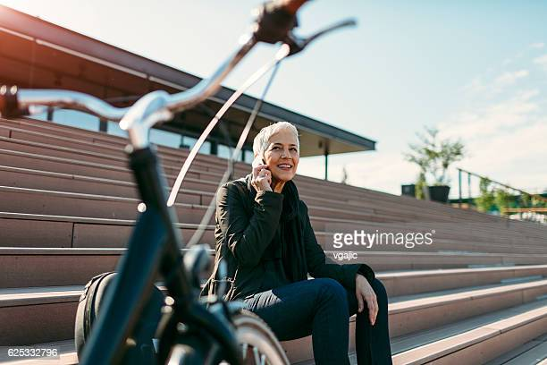Smiling Mature Woman Talking On The Phone.