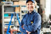 Smiling mechanic portrait