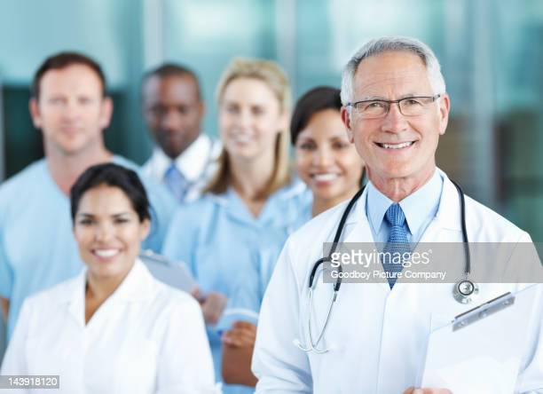Smiling medical professional with team
