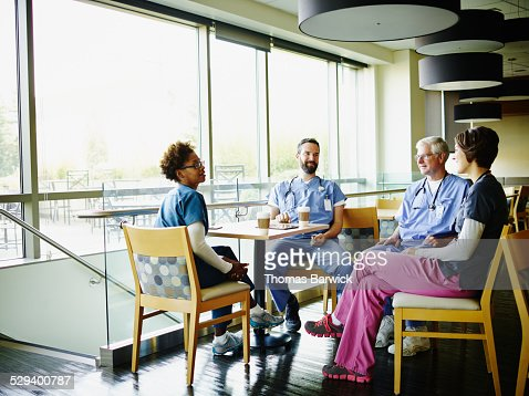 Smiling medical team in discussion during break