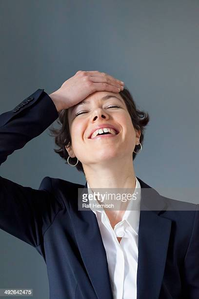 A smiling mid adult woman having an aha moment, close-up