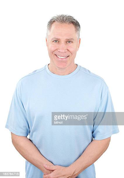 Smiling middle age man with light blue shirt