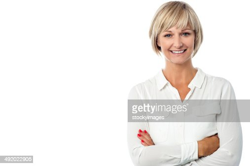 Smiling middle aged lady, arms crossed. : Stock Photo