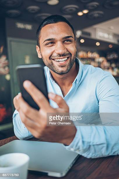 Smiling Middle Eastern ethnicity man in cafeteria