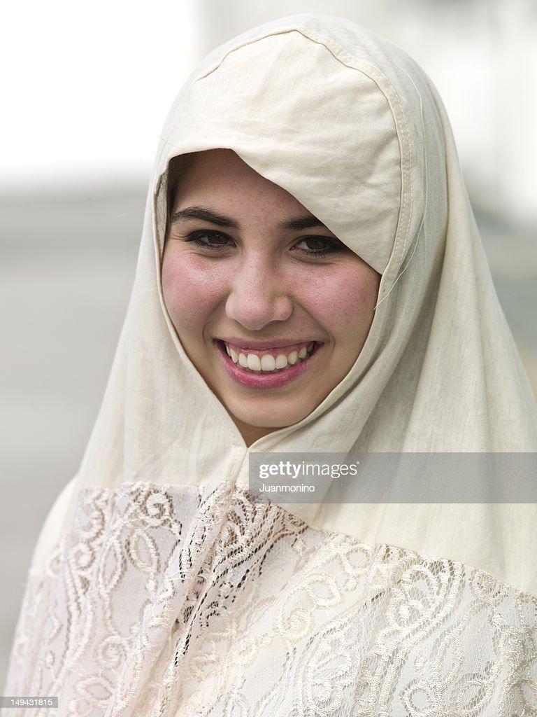 Smiling middle eastern teenage girl : Stock Photo